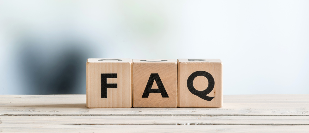 FAQ sign made of wood on an office table